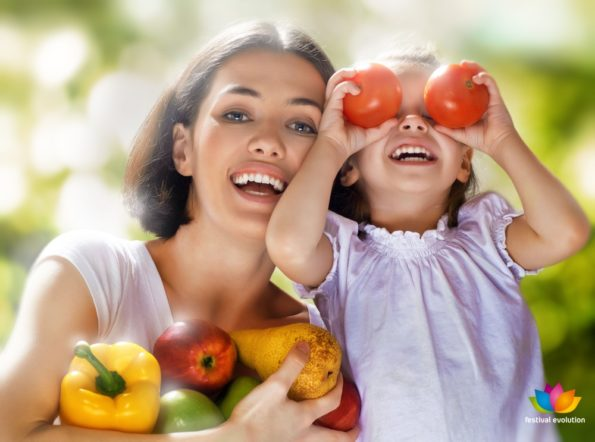 happy family keeps fresh vegetables